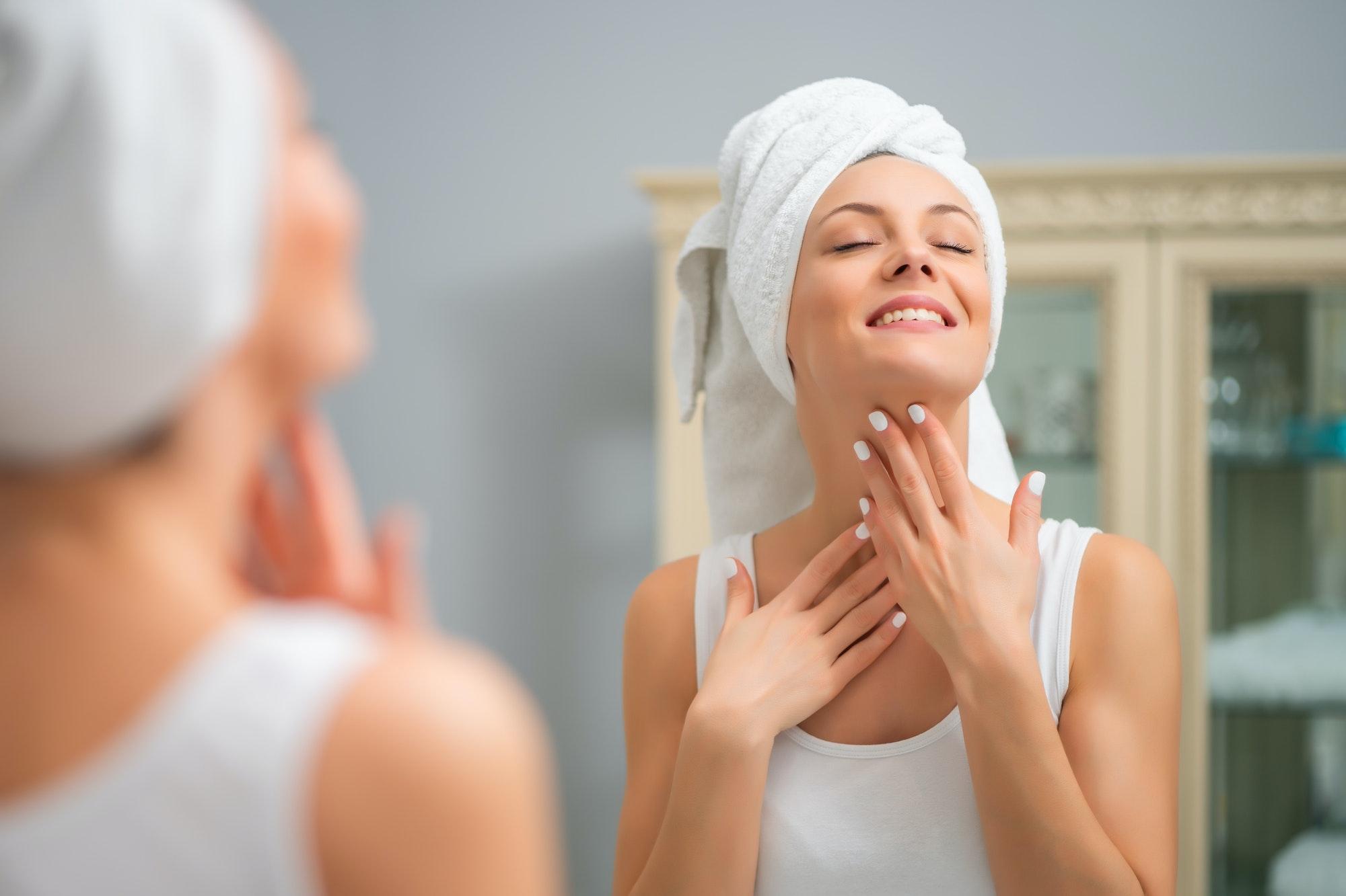 Woman applying moisturizer to her skin