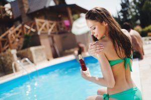 Woman careful not to get sunburn